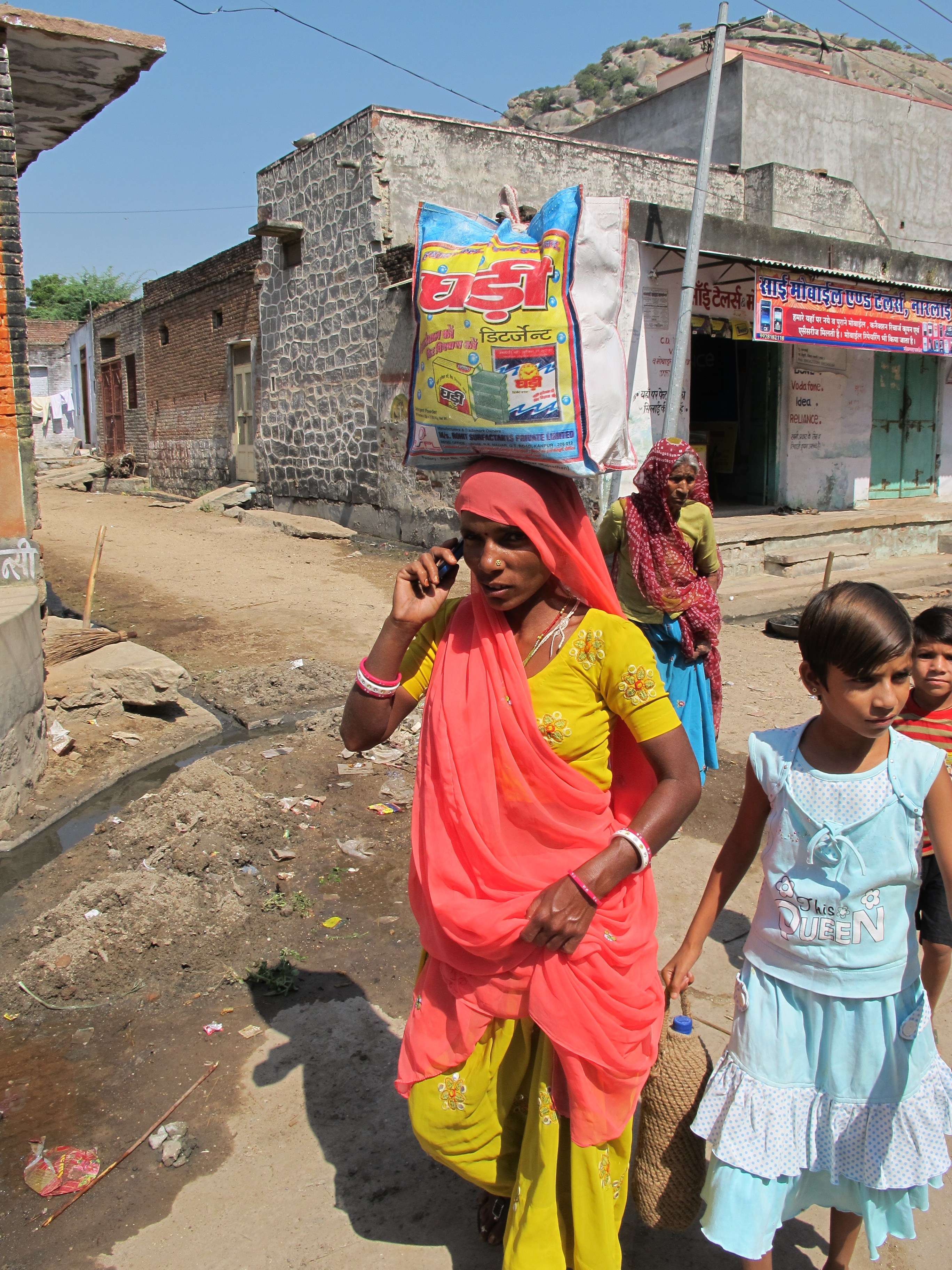 Woman in sari with cell phone - Narlai - India