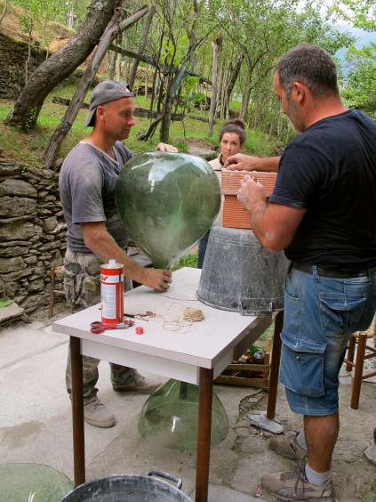 Enzo and Donatello_Cutting wine jug_Favale_Italy